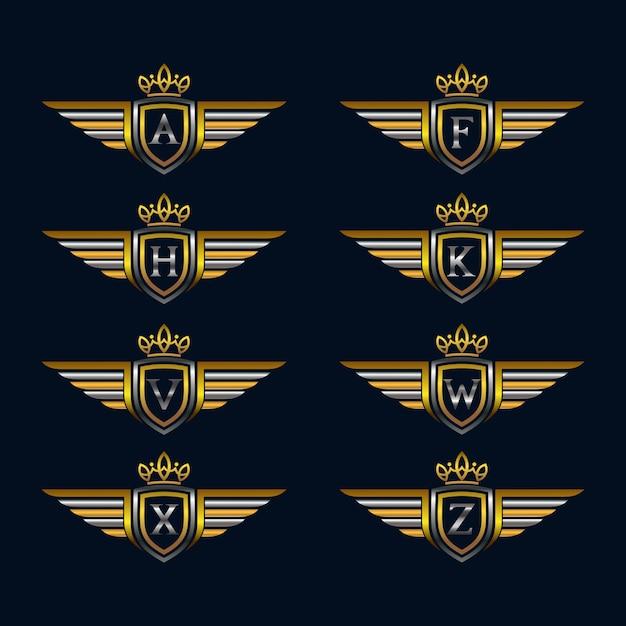 Flügel mit alphabet und schild logo sammlungen Premium Vektoren