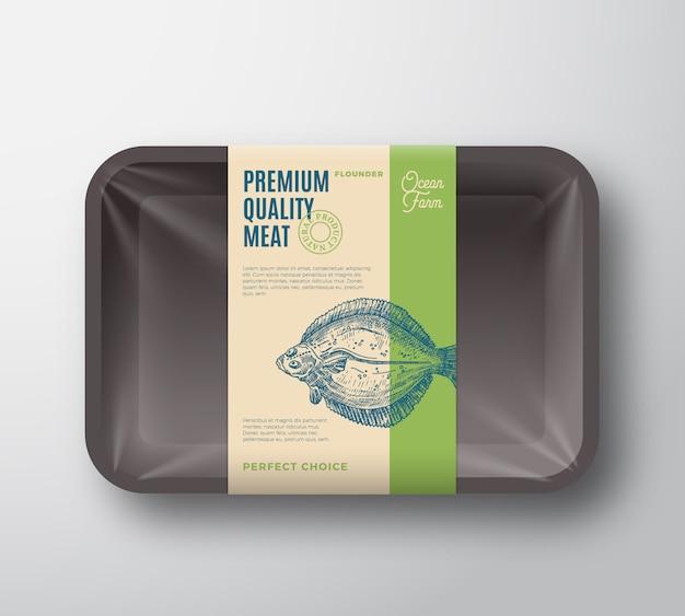 Flunder in premiumqualität. abstrakte fischplastikschale mit zellophanabdeckung verpackung design label. moderne typografie und handgezeichnetes plattfisch-silhouette-hintergrundlayout. Premium Vektoren