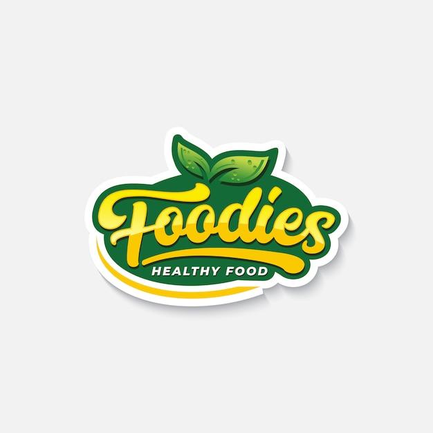 Foodies-typografielogo oder -aufkleber für gesundes lebensmittel Premium Vektoren