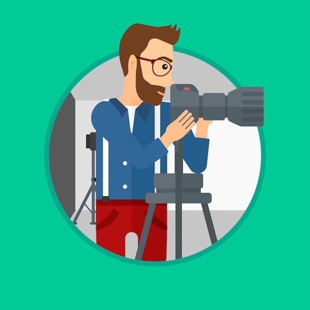 Fotograf, der mit kamera auf stativ arbeitet. Premium Vektoren