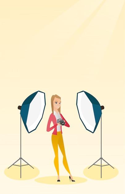 Fotograf mit einer kamera in einem fotostudio. Premium Vektoren