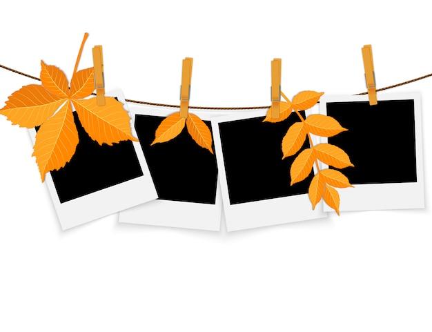 Fotorahmen auf seil mit wäscheklammern und herbstlaub Premium Vektoren