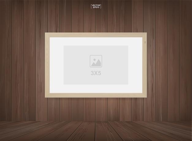 Fotorahmen im hölzernen raumraumhintergrund. Premium Vektoren