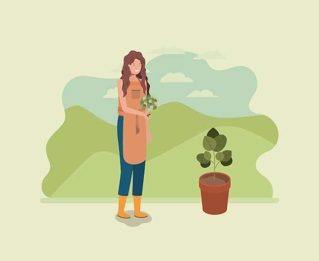Frau, die baum im park pflanzt Premium Vektoren