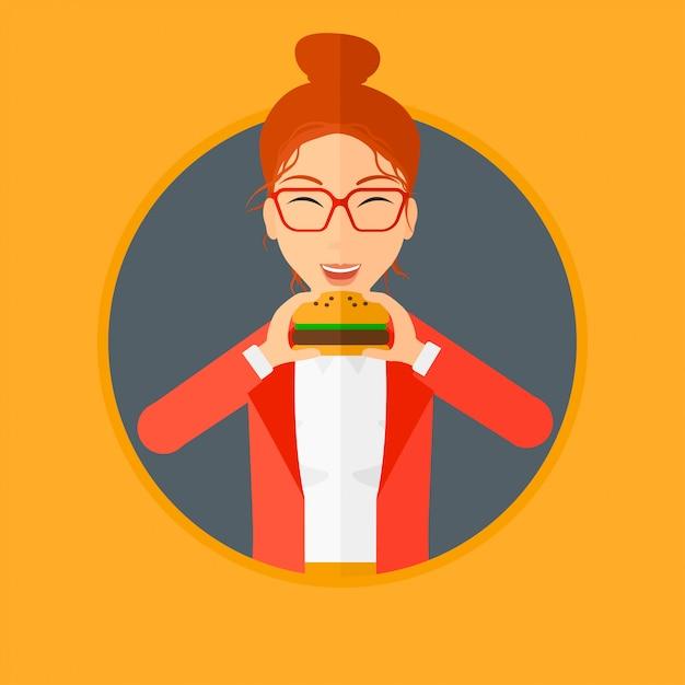 Frau, die hamburger isst. Premium Vektoren