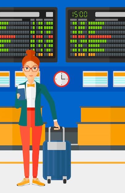 Frau, die mit koffer steht und karte hält Premium Vektoren