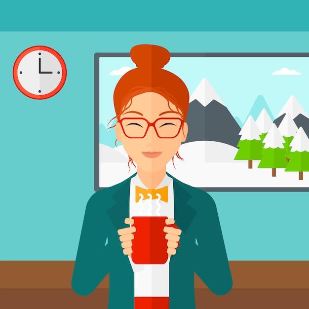 Frau, die mit tasse kaffee sitzt Premium Vektoren