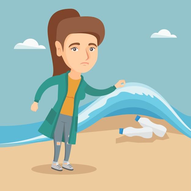 Frau, die plastikflaschen unter meerwasser zeigt. Premium Vektoren