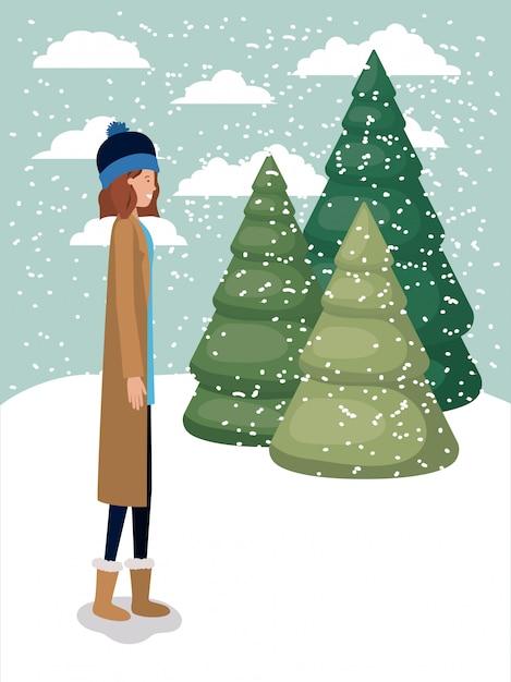 Frau in der schneelandschaft mit winterkleidung Premium Vektoren