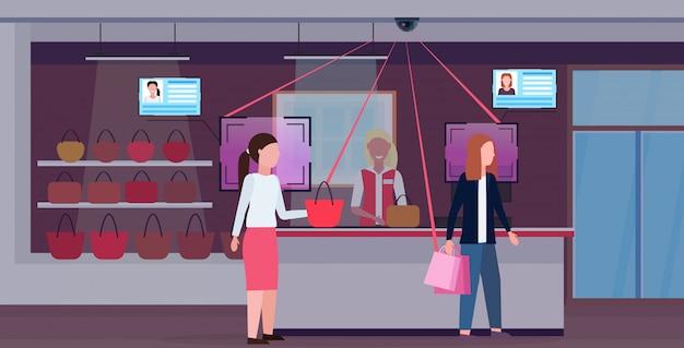 Frau kauft handtasche an der kasse kundenidentifikation gesichtserkennungskonzept überwachungskameraüberwachung cctv-system weibliches zubehör boutique interieur horizontal in voller länge Premium Vektoren