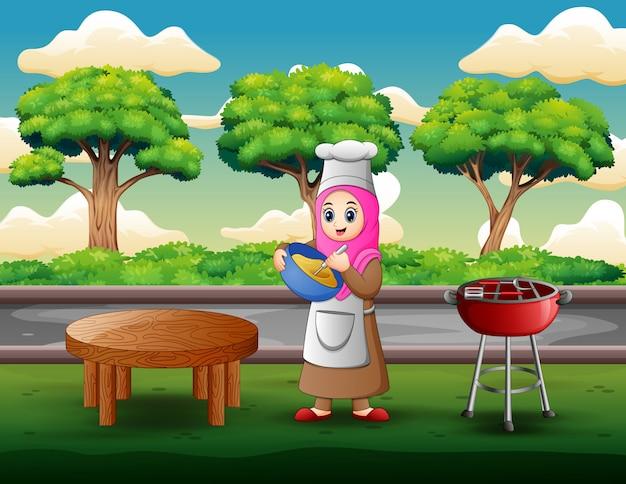 Frau macht teig und draußen kochen Premium Vektoren
