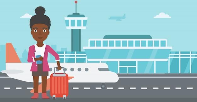 Frau mit koffer und ticket am flughafen. Premium Vektoren