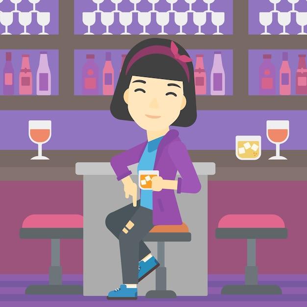 Frau sitzt an der theke. Premium Vektoren