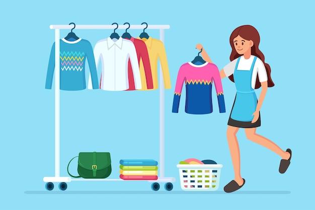 Frau wählt und probiert kleid an. mädchen in der nähe von kleiderschrank. metallregal mit kleidung, taschen auf kleiderbügeln in der boutique. ladenstand mit modischem outfit. innenraum der umkleidekabine. Premium Vektoren