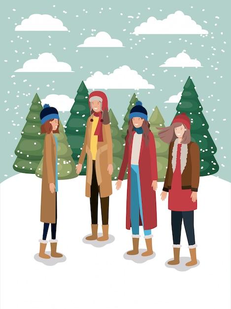 Frauengruppe in der schneelandschaft mit winterkleidung Premium Vektoren