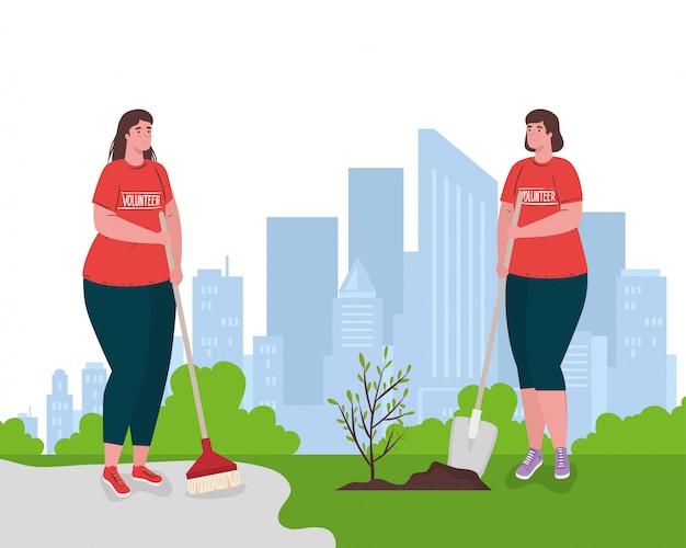 Freiwillige frauen mit pinsel und schaufel pflanzen Premium Vektoren