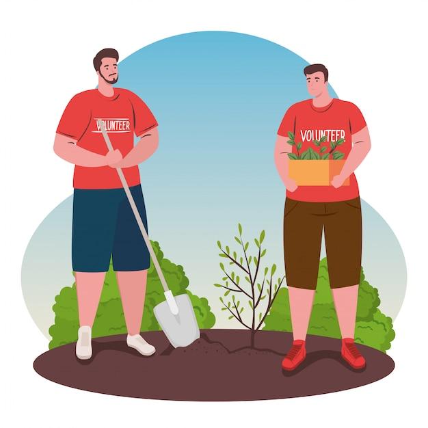 Freiwillige männer mit schaufelpflanzung Premium Vektoren