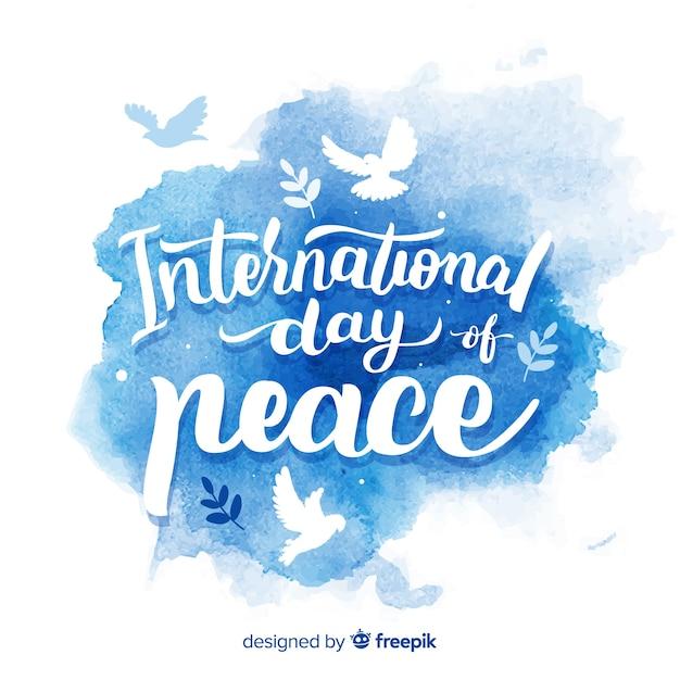 Friedenstag aquarell schriftzug hintergrund Kostenlosen Vektoren