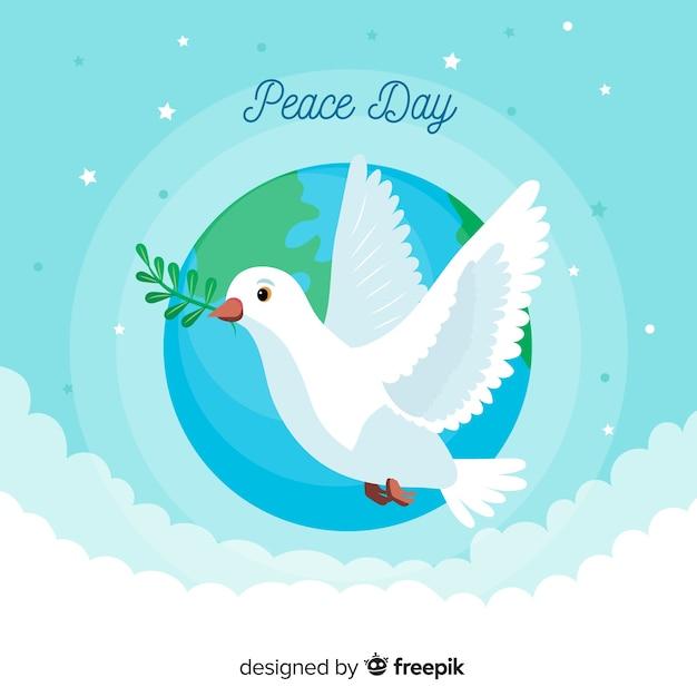 Friedenstag mit flachem design der taube Kostenlosen Vektoren