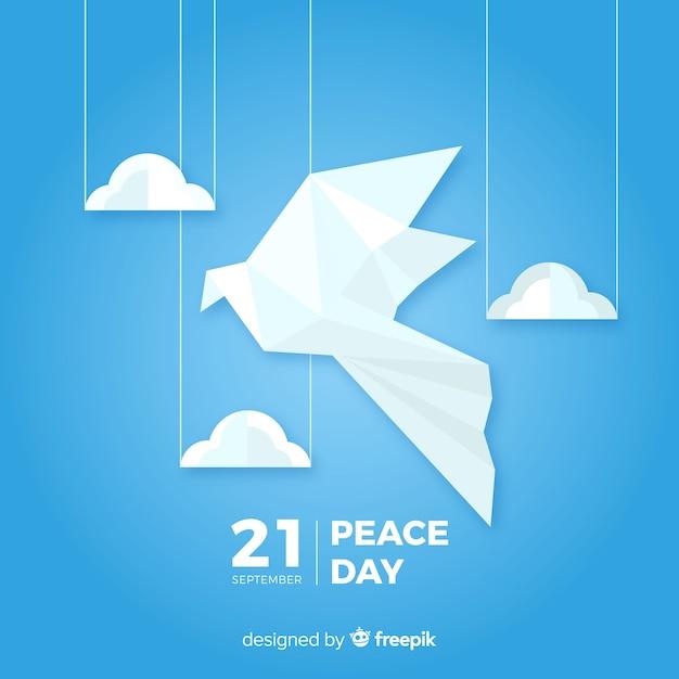 Friedenstageshintergrund mit origamidaube Kostenlosen Vektoren