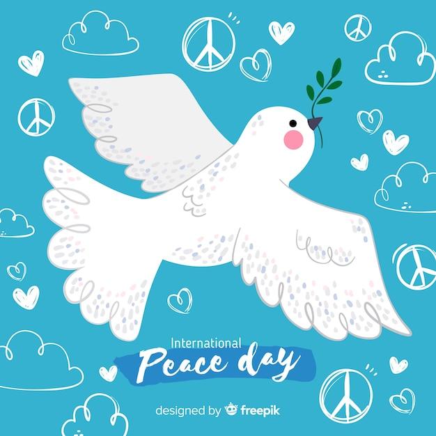 Friedenstageshintergrund mit weißer taube Kostenlosen Vektoren