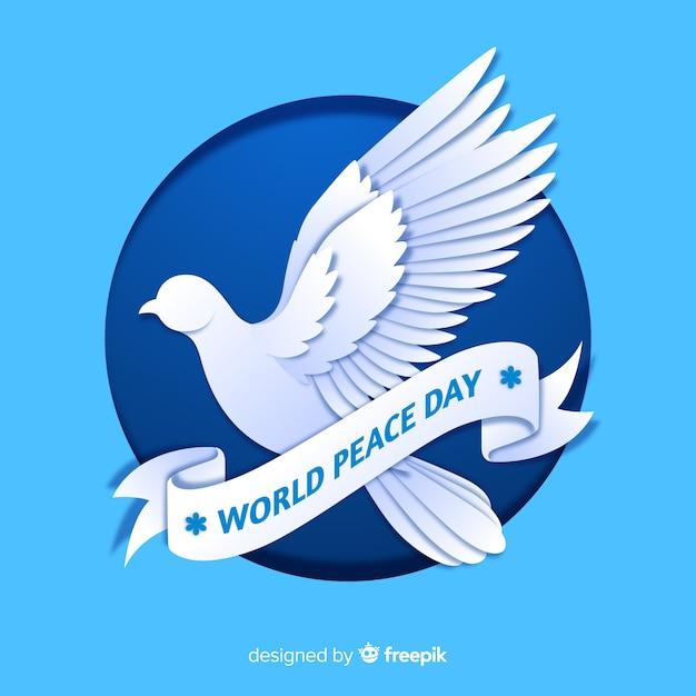 Friedenstageskonzept mit einer taube Kostenlosen Vektoren