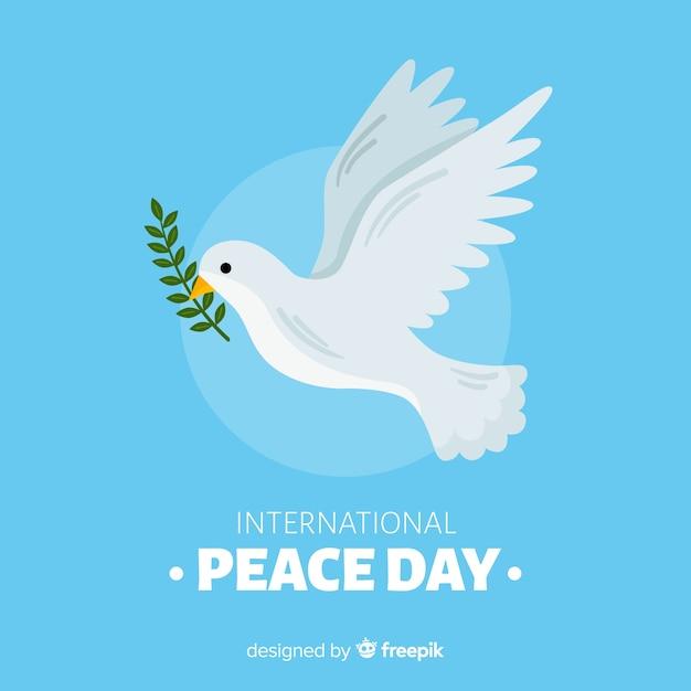 Friedenstageskonzept mit hand gezeichneter taube Kostenlosen Vektoren