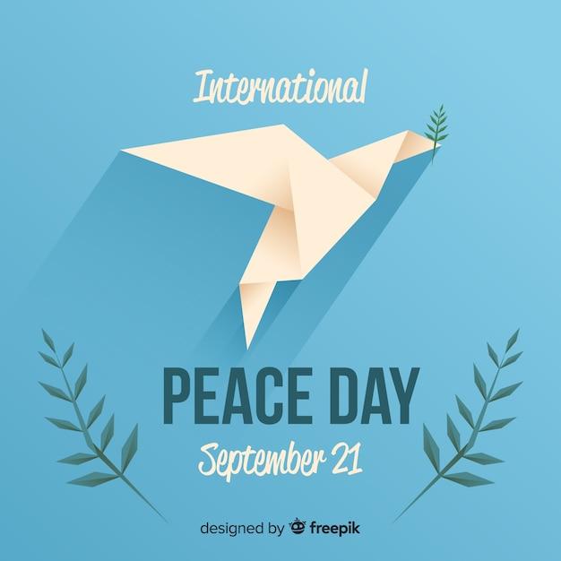 Friedenstageskonzept mit origamitaube Kostenlosen Vektoren