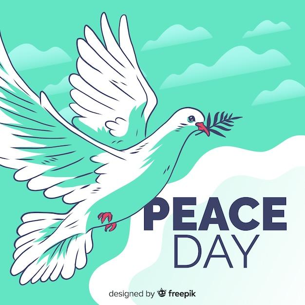 Friedenstageszusammensetzung mit hand gezeichneter weißer taube Kostenlosen Vektoren