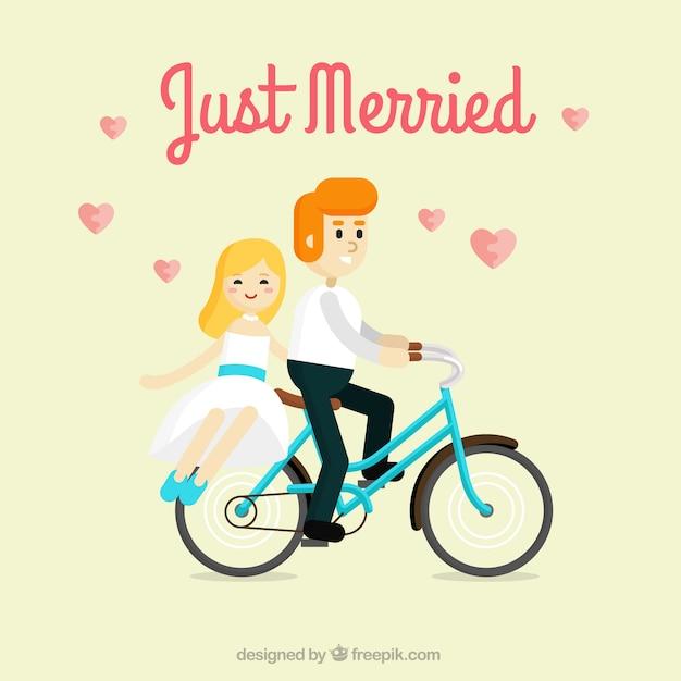 Frisch verheiratete paar auf dem fahrrad Kostenlosen Vektoren