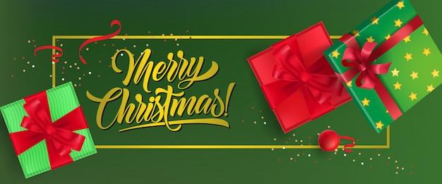Frohe weihnachten-banner-design. geschenkboxen mit bändern Kostenlosen Vektoren