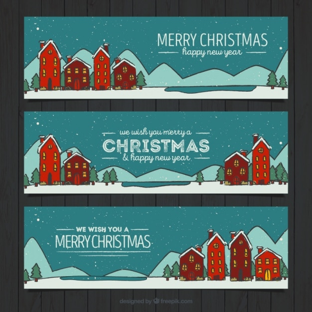 frohe weihnachten banner mit zeichnungen von h usern download der kostenlosen vektor. Black Bedroom Furniture Sets. Home Design Ideas