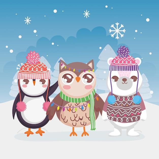 Frohe weihnachten des netten eisbärpinguin- und -eulenschneelandschaftswinters Premium Vektoren