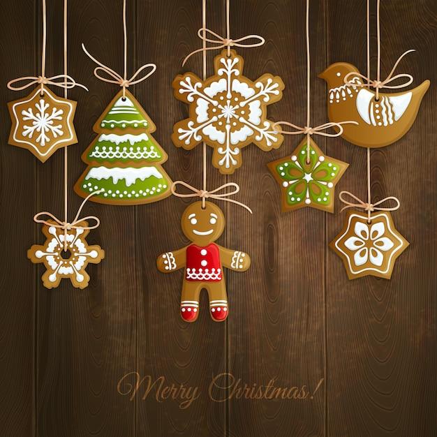 Frohe weihnachten grußkarte mit keksen Premium Vektoren