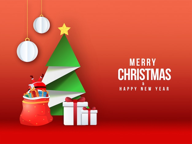 Frohe weihnachten & happy new year grußkarte mit kreativen papier weihnachtsbaum, santa fallen in geschenktüte und kugeln hängen auf rot. Premium Vektoren