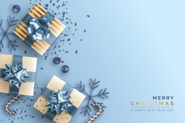 Frohe weihnachten hintergrund mit realistischen geschenken Kostenlosen Vektoren