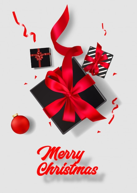 Frohe weihnachten poster. draufsicht über schwarze geschenkbox auf weißem hintergrund Premium Vektoren