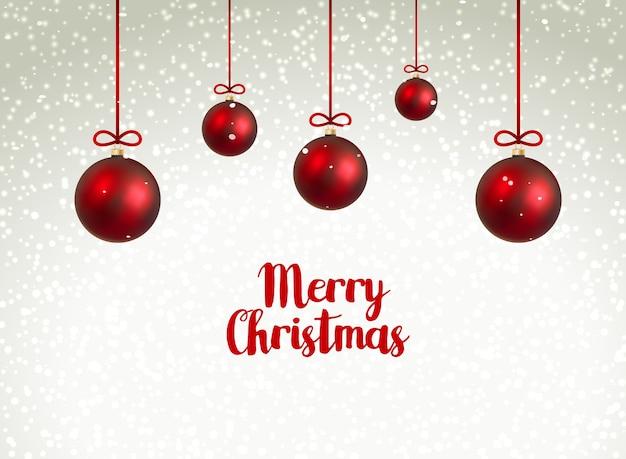 Frohe weihnachten rote kugeln. weihnachtsdekoration mit luxuskugeln. feiertagswinterfeier. Premium Vektoren