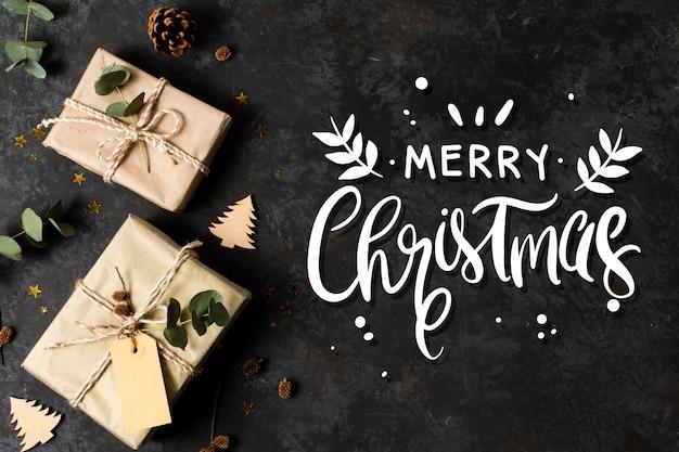 Frohe weihnachten-schriftzug auf weihnachtsfoto Kostenlosen Vektoren