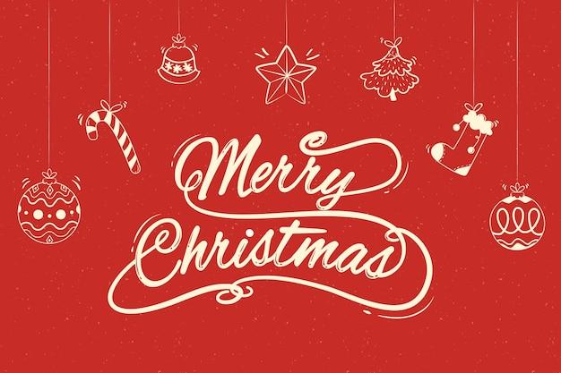 Frohe weihnachten-schriftzug mit hängenden weihnachtsschmuck Kostenlosen Vektoren