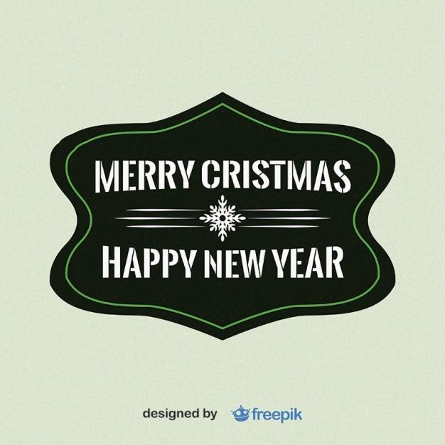 Frohe weihnachten und ein glückliches neues jahr mit schneeflocke in der mitte etikett Kostenlosen Vektoren