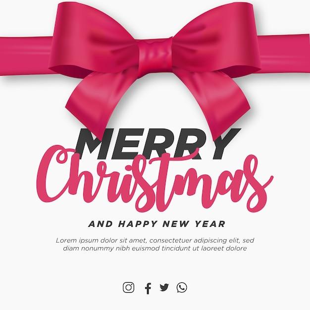 Frohe weihnachten und ein gutes neues jahr mit realistischem rosa band Kostenlosen Vektoren