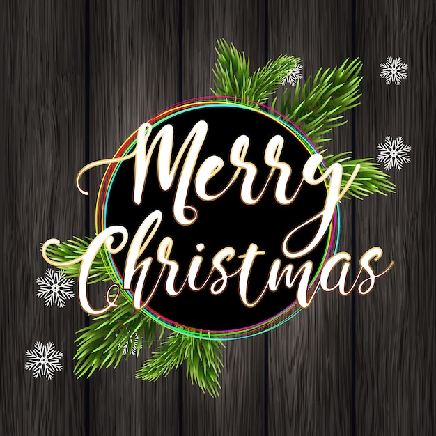 Frohe weihnachten und fichtenzweige auf einem hölzernen hintergrund. Premium Vektoren
