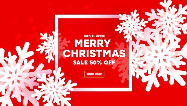 Frohe weihnachten und neujahr mit luftigen weißen schneeflocken und rahmen mit text auf einem roten steigungshintergrund. Premium Vektoren