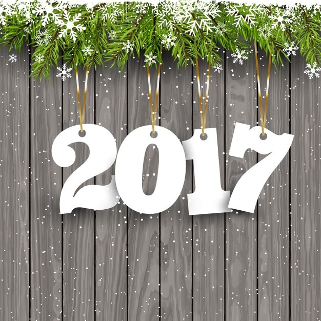 Frohes Neues Jahr Hintergrund mit hängenden Zahlen auf einem schneebedeckten Holz Hintergrund Kostenlose Vektoren