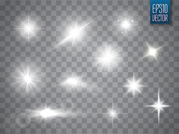 Funken isoliert. vektor leuchtende sterne. lens flares und sparkles Premium Vektoren