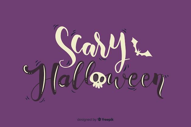 Furchtsame halloween-beschriftung mit dem schädel Kostenlosen Vektoren