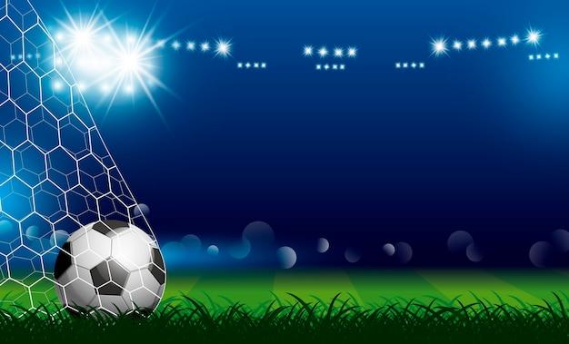 Fußball im ziel auf gras mit scheinwerfer Premium Vektoren