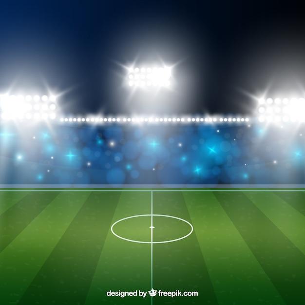 Fußballstadionhintergrund in der realistischen Art Kostenlose Vektoren
