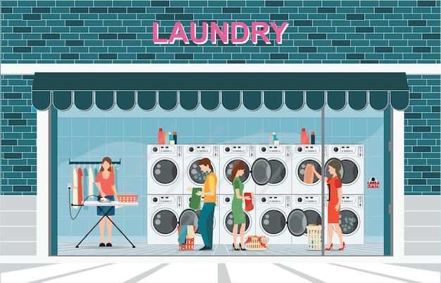Gebäude der waschküche mit reihe der industriellen waschmaschinen Premium Vektoren